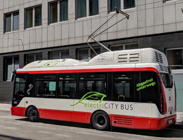 Electric city bus in the charging station